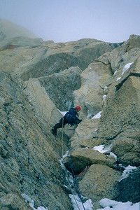 Joe Puryear on a steep rock pitch on Mount Huntington's Harvard Route.