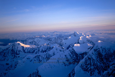 View southwest from 14,000 feet on Mount Foraker's Infinite Spur. On the right is Mount Russell, in the center in the far distance are the remote Kichatna Spires.