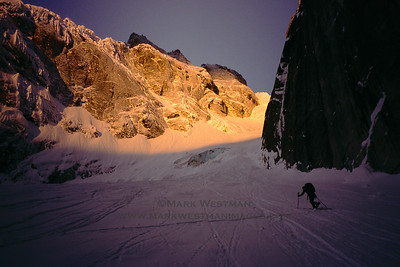 Eamonn Walsh early in the morning in the approach gully to a new route on Mount Grosvenor, Ruth Gorge.