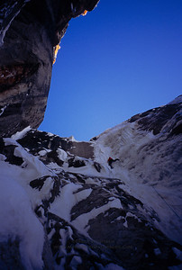 Eamonn Walsh climbs thin, overhanging, and detached ice during the first ascent of the east face of Broken Tooth.