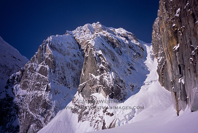"The 4,400 foot east face of Mount Grosvenor. In 2006, Eamonn Walsh and I made the first ascent of the obvious corner splitting the face, a route we called ""The Warrior's Way"". A year earlier, we made another first ascent of a route high on the right side of the face, beginning from about half way up the big gully to the right and into a not-visible slot. We named that route, ""Once Were Warriors"". We also did another, easy new route on the backside that same season. The three new routes were the mountain's 2nd, 3rd, and 4th recorded ascents."
