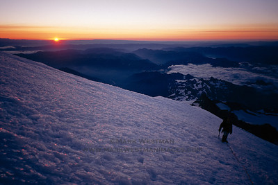 Sunrise from 13,000 feet on Mount Rainier.