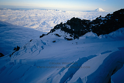 US Army CH-47 Chinook helicopter landing at Ingraham Flats, Mount Rainier, during a rescue for injured climbers. Mount Adams stands in the distance.