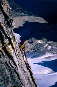 Exposed climbing on the northeast ridge of Bugaboo Spire, British Columbia.