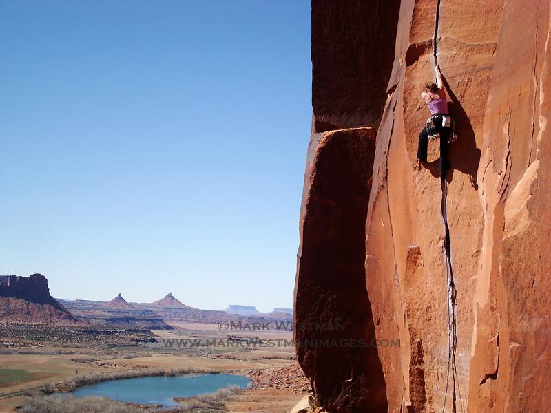 "Climbing ""Scarface"" in Indian Creek, Canyonlands National Park, Utah."
