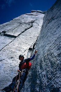 Colin Haley at the foot of the massive corner system on All Along the Watchtower, North Howser Tower, Bugaboos, British Columbia.