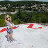 """Sentinel & Enterprise Reporter Anna Burgess hikes to Fitchburg's famous rock, known mainly for the paintings each high school class paints on it annually. A guided """"rock walk"""" will be held on October 1st starting at 10 A.M. SENTINEL & ENTERPRISE / Ashley Green"""