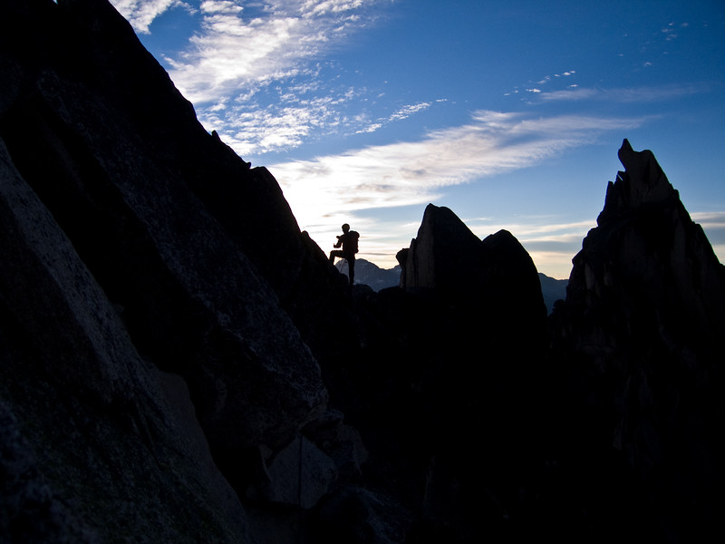 Silhouetted climber on Snowpatch Spire, Bugaboos