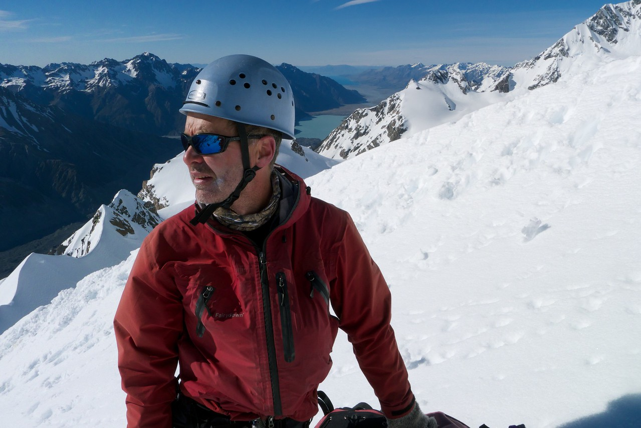 Stu on the east ridge of Dixon with the Tasman terminal lake and valley behind.