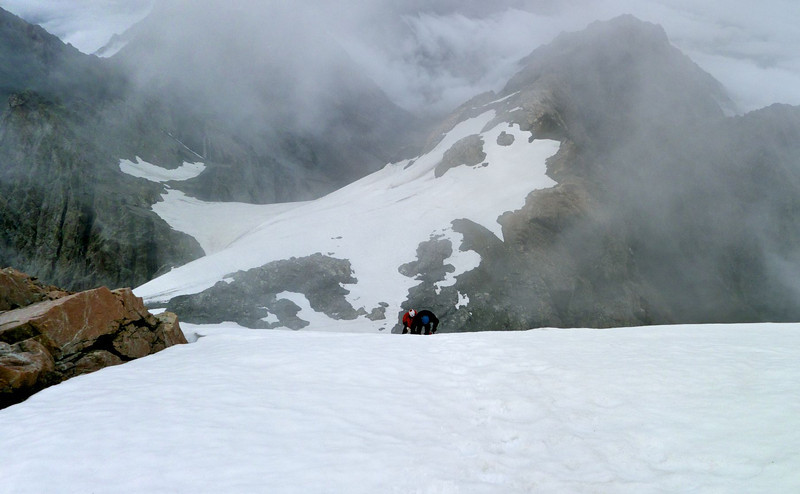As we climb the final summit slopes, clouds sweep in from the north.