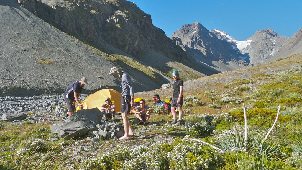 Setting up camp in sight of the summit at 1300m in Gorilla Stream.