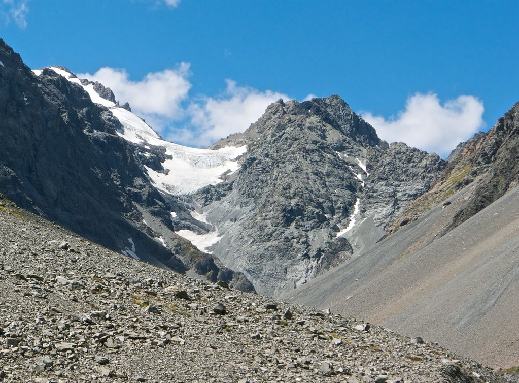 Seeing this I wondered how we would negotiate a route between the lower snow and main glacier.  I favoured the steeper rocks on the right but decided to sleep easy and wait to see what it would look like close-up.
