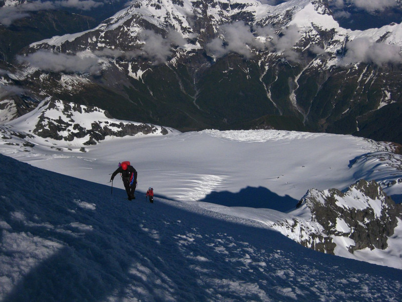 Patrick and Stu approaching the summit with NW ridge and Bonar Glacier below.