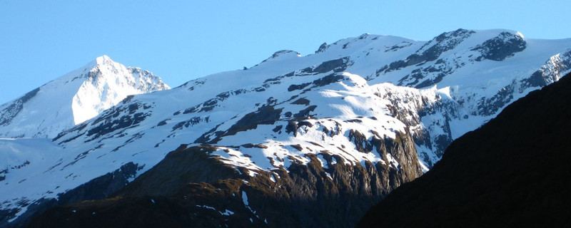 Sunday November 7. We are taking the Bevan Col route to Colin Todd Hut.  This shot shows French Ridge, which we pass by, and behind it the sharp, steep south-west ridge of Mt Aspiring.