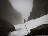 Descending the happy fun couloir of rain and choss.