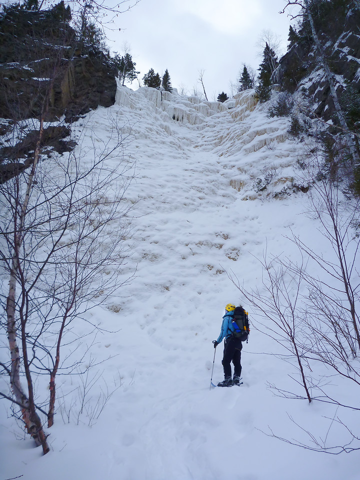 Orient Bay, Ontario<br /> Tempest ice climb<br /> Kejal checking out the climb after heavy snow fall