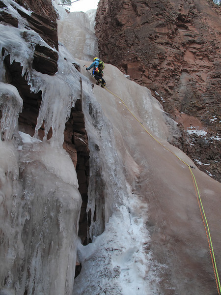 North Shore, MN<br /> Devil's Track River<br /> Nightfall ice climb<br /> Kejal on first pitch