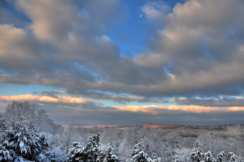 The view from Jeff's deck after a snow, with the setting moon.