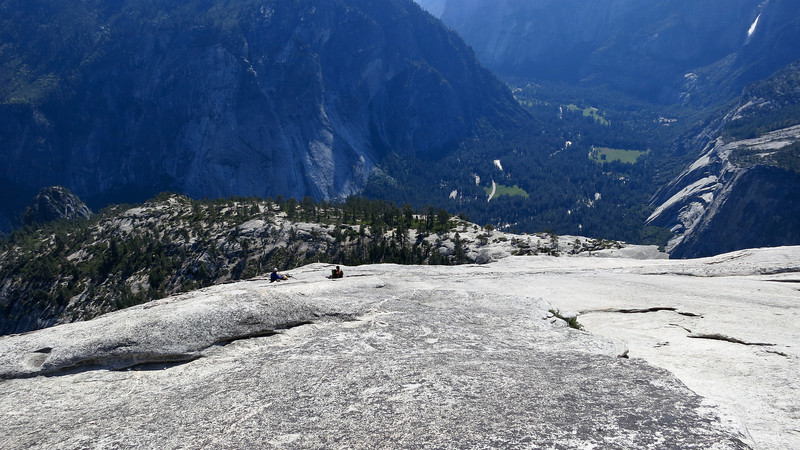 4:37pm - Done with the roped technical climbing section and now walking up the 3rd class slabs to the top. Yosemite Falls and the Valley in the background. Guys below are the slow party that were ahead of us, still moving slow, but at least there is now room for us to pass.