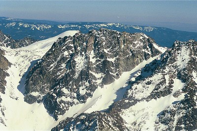 Dragontail Mt, Washington Cascades (3K face). Climbed the north face a couple times, and had a nice time part way up serpentine arete in the middle. Mt Colchuck, my first climb, is the right. The Enchantments are the basin to left after topping out of 2K Asguard pass.