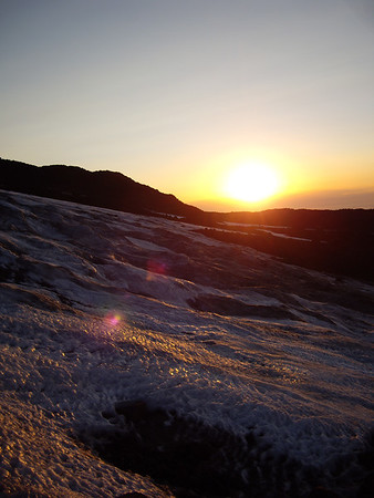 Sunrise over the South Snowfields of the false summit.