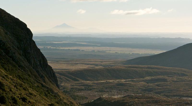 Bomb Bay cliffs in profile, with Mt Taranaki about 70km distant