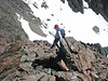 Alistair drops to the snowfield for the final part of the ascent (Marion Castle)