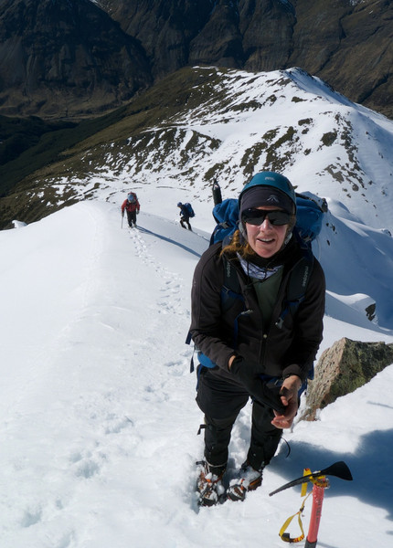 Alison stops for a break in rapidly softening snow high on the south east ridge of Paske