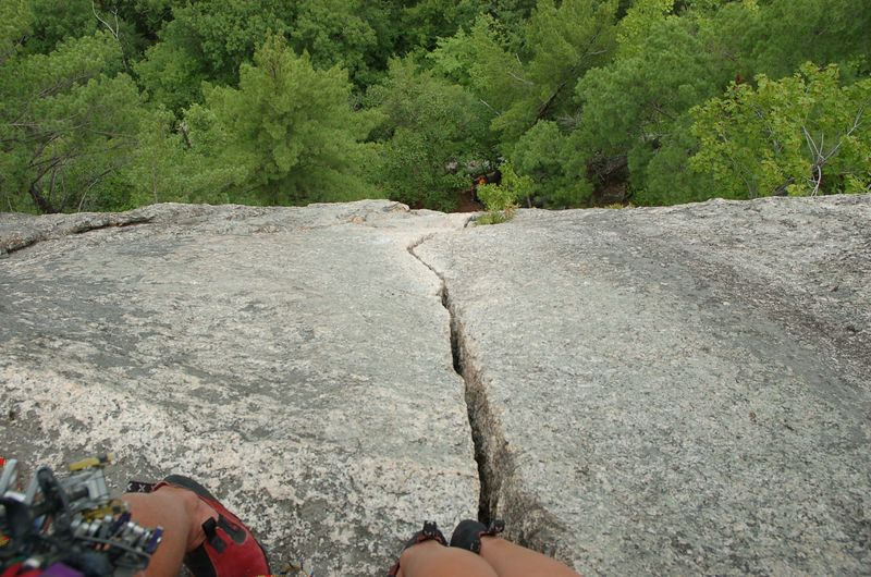 Looking down from the belay below the top at the long 5.8 crack on Inferno.