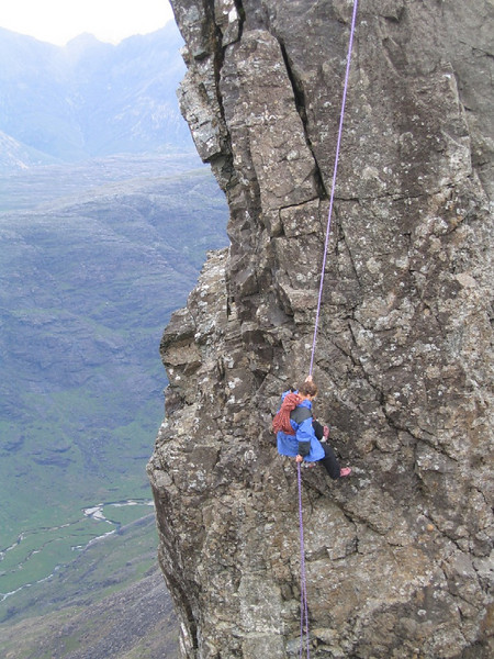 Gavin abseiling off the Inn Pin, Skye.