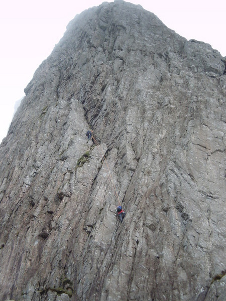 Rannoch Wall on the Buachaille. Climbers on Agags Groove.