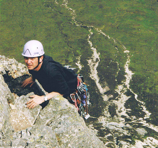 Jules topping out on Agag's Groove, Glen Coe.