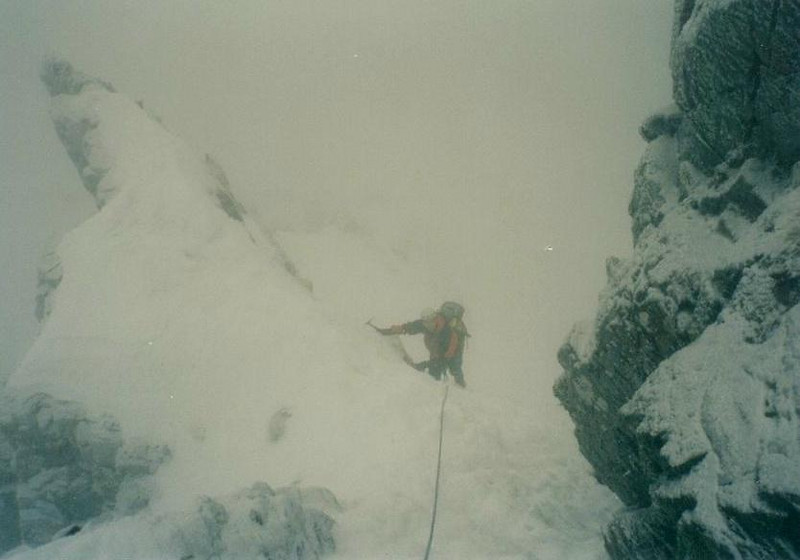 Scott climbing through the mirk on Dorsal Arete, Glen Coe