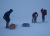 Typical Cairngorm winter weather! Neil, Scott, Fraser packing away climbing gear at the top of a route in Sneachda.