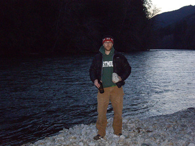 Me, next to river, with rock.