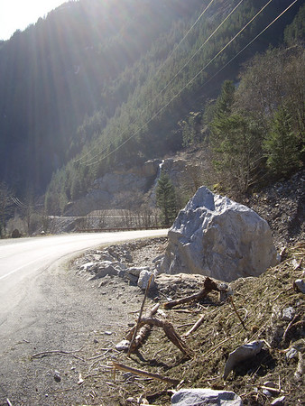 Boulder that was moved onto the road by an avalanche this winter.
