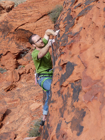 Kyle clipping the anchor on a fun 10a at the Magic Bus.