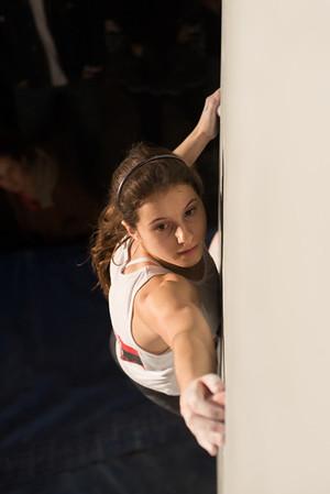 Olivia climbing well on problem #4