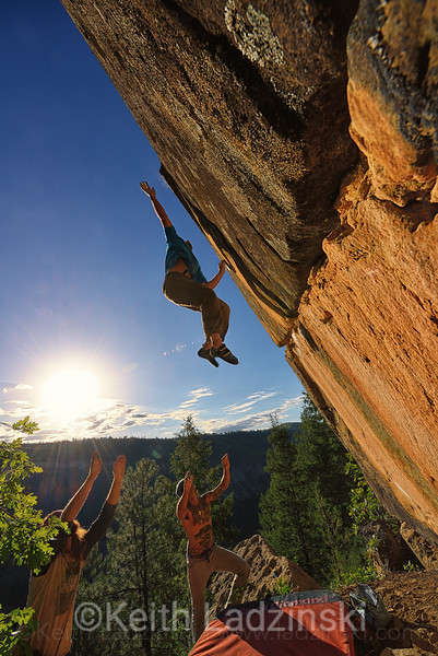 Rock climber Chris Shulte throwing for the lip of a rock while rock climbing  on beautiful ganite in the San Juan Mountains near Durango Colorado