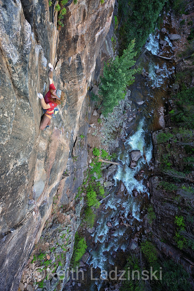 Rock climber Richie Hum climbing on small holds and beautiful ganite in the San Juan Mountains near Durango Colorado