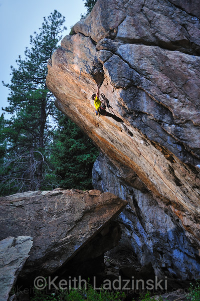 Rockclimber John Cardwell climbing a rock face in 11 Mile Canyon, Colorado