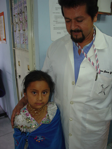Dr. Lenin greets a new patient dressed in traditional clothing of the region. So cute!