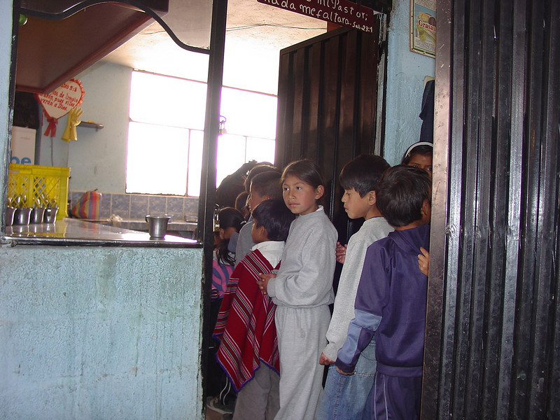 The church and the clinic are related to an organization called CDN #459. The Center for Child Development. This church outreach program provides meals, classrooms and organized activities for over 500 children. It provides a hot lunch every day for over 200 children. Here, the children are proceeding into the kitchen to get their lunches.