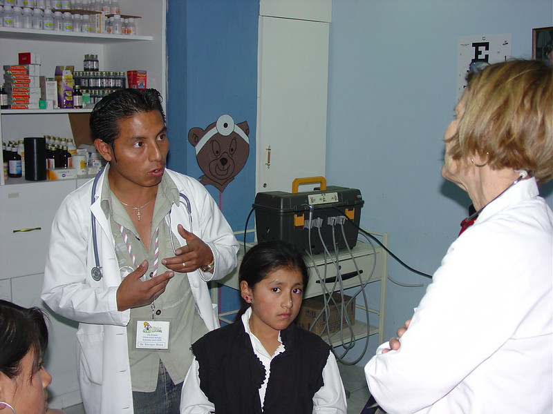 Enrique discusses a case with Rita. The child has a bad infection on the skin around her ear.
