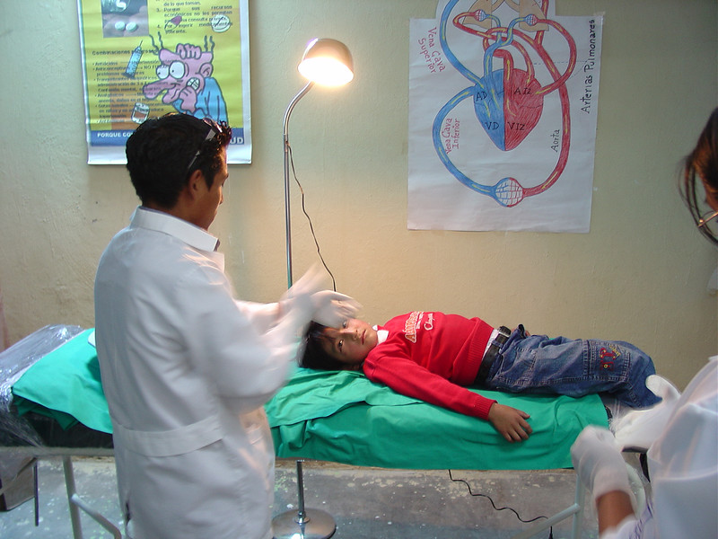 Enrique prepares to treat one of our first patients who has suffered a cut very close to his eye.