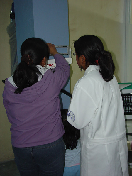 Ceci and her sister, who is also a nurse, test out the clinic's scale on opening day.