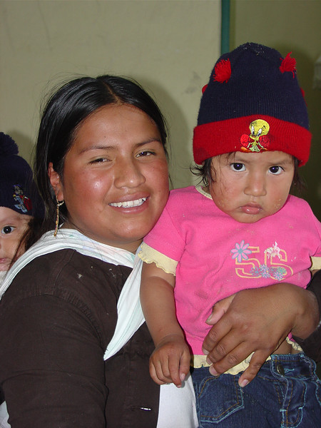 A young mother and child wait for the clinic to open on the day of its inauguration.