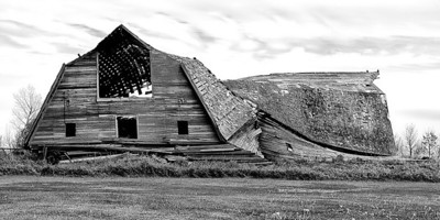 Abandoned old barn is unique due to its double design.  Only time will tell how long it stands.
