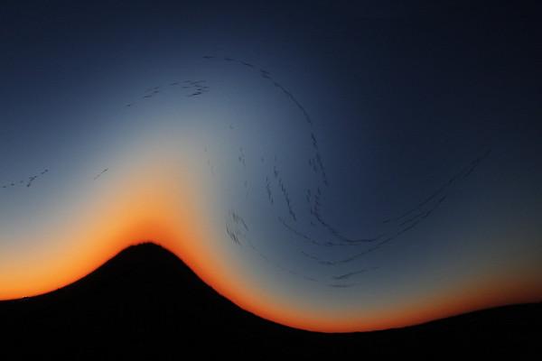 AR-Geese Flying Over Mountain at Nightfall-Richard Kerbes