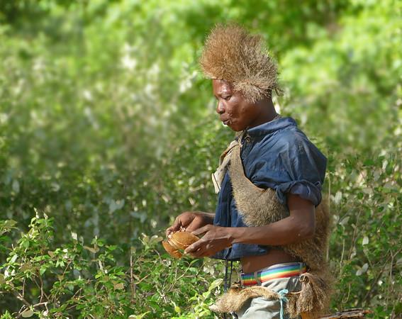 PE-Hadza Hunter Munching Baobab-Gayvin Franson